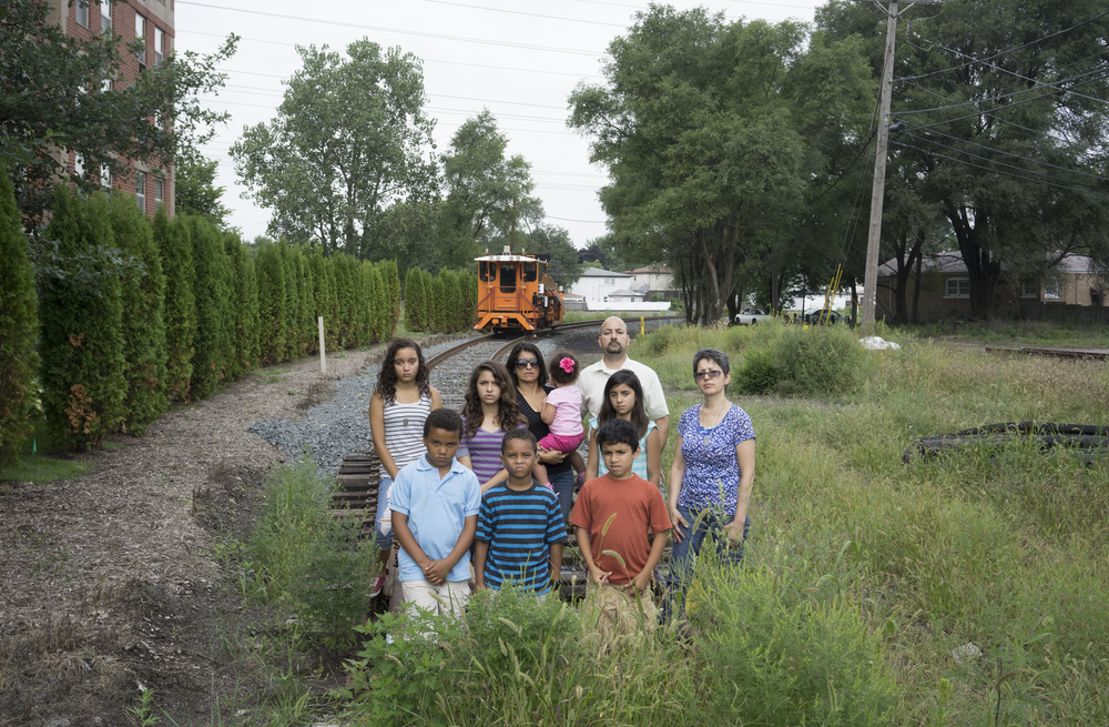 The Martinez family symbolically blocking the new petcoke shipping rail spur, 2014. Terry Evans