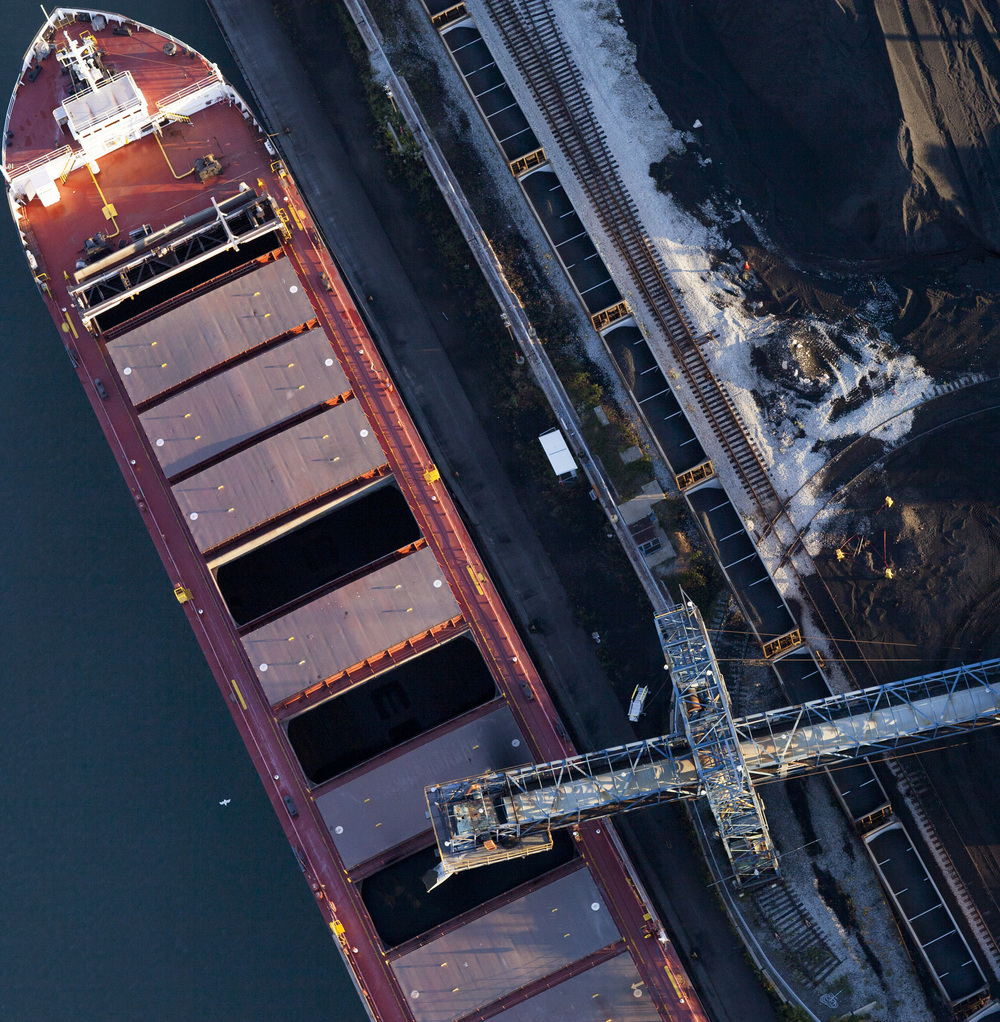 Loading petcoke onto a barge on Calumet River, 2015. Terry Evans