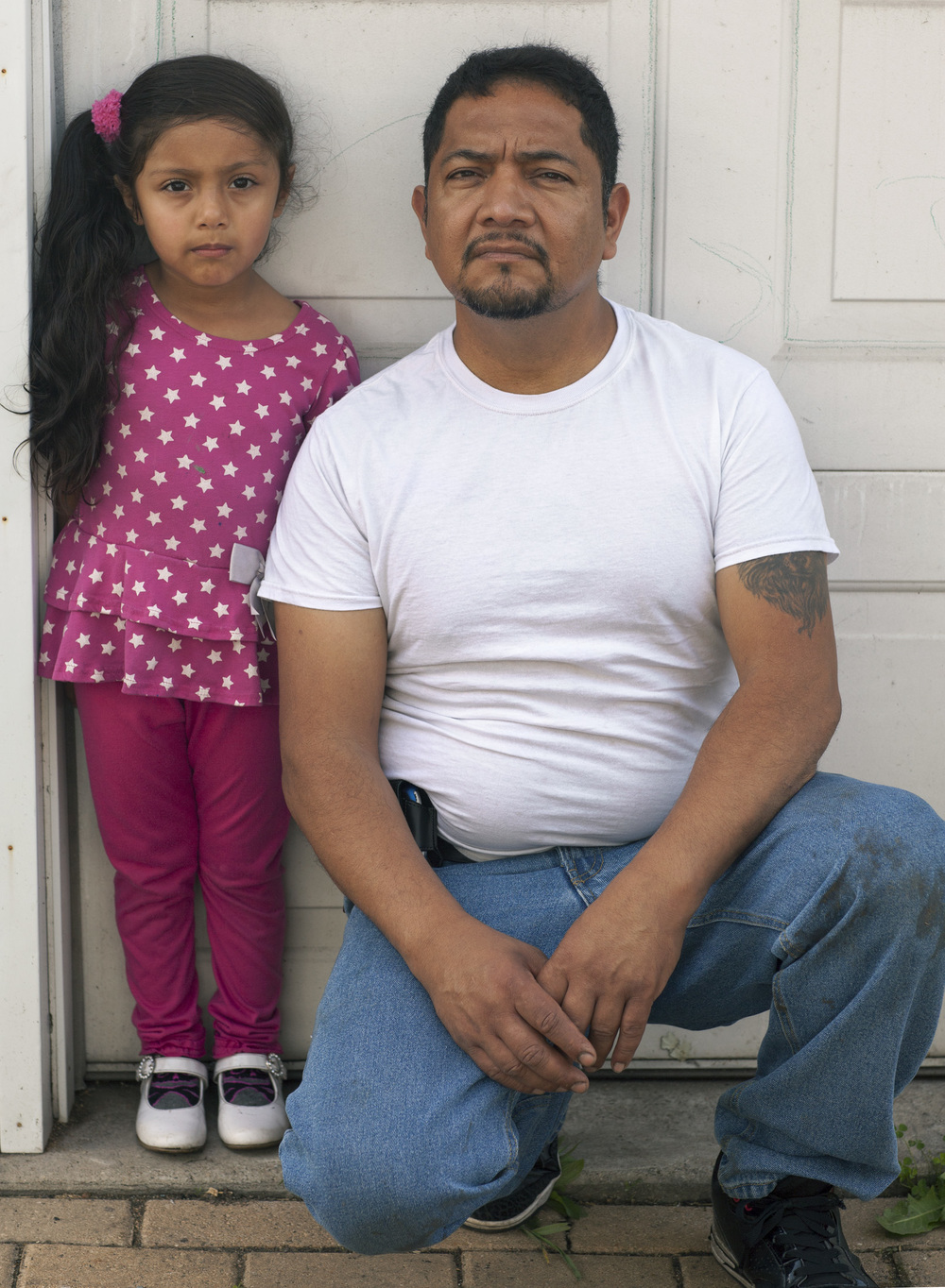 Martin Morales, activist, and his daughter, Scarlet, 2015. Terry Evans