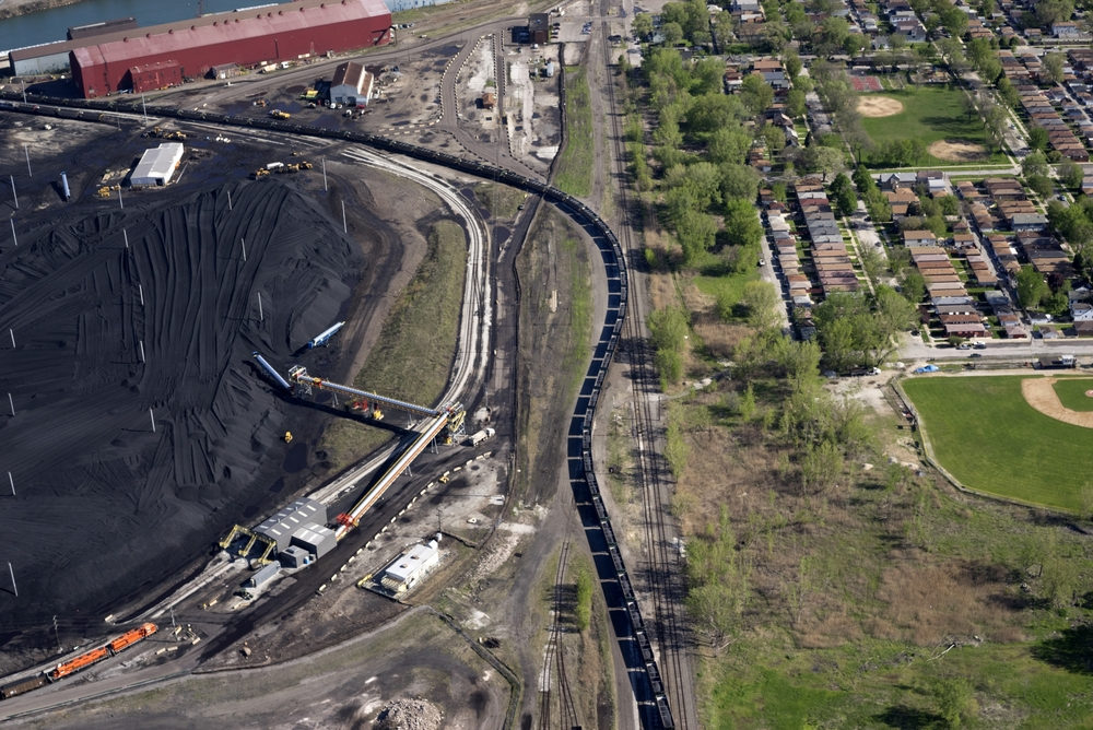 Petcoke filled train snaking through the neighborhood, Southeast Side, Chicago, IL 2015. Terry Evans