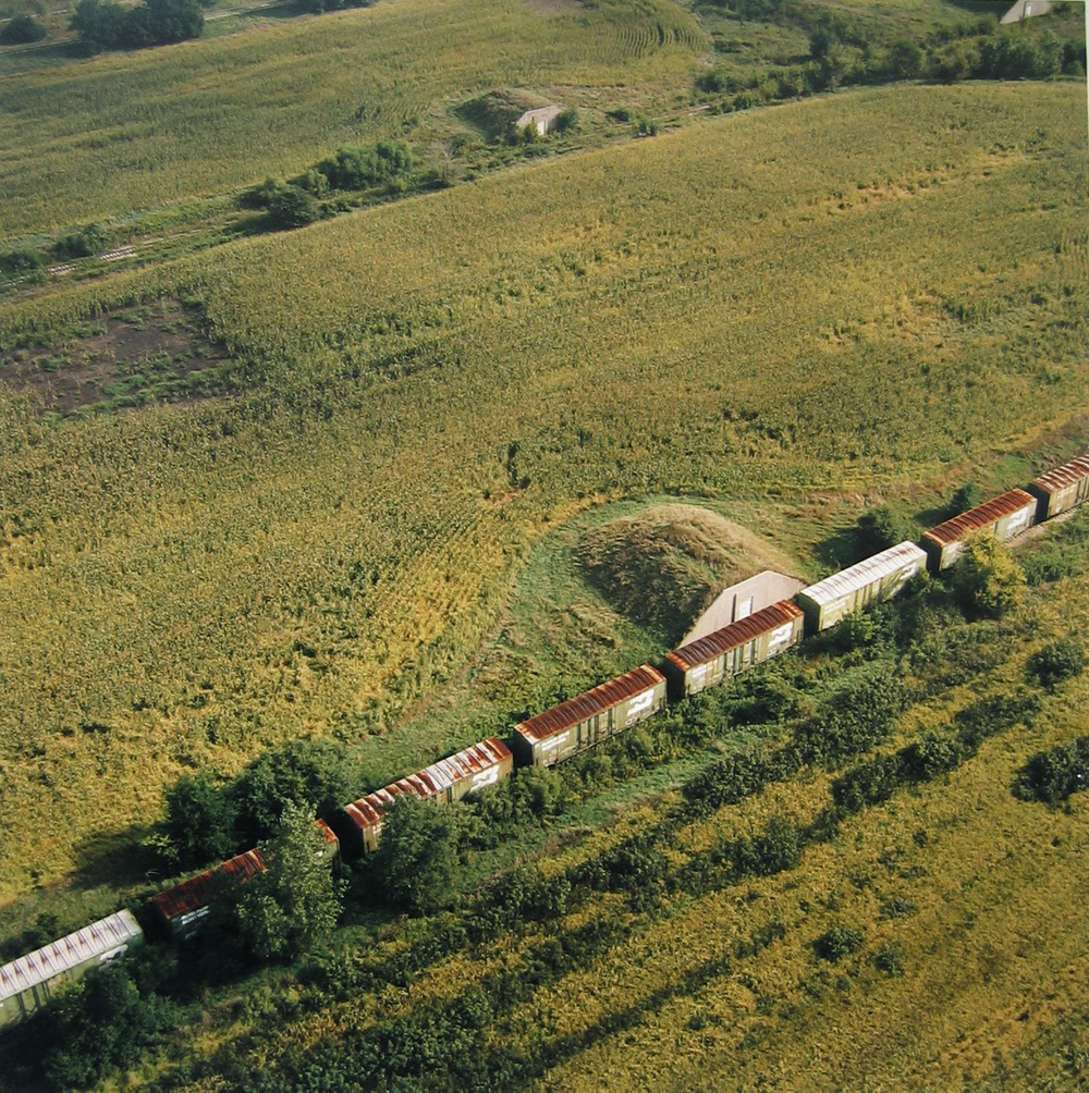 Abandoned bunkers and train, now cornfield, Sept. 1995.jpg