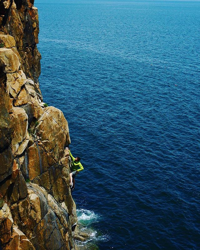 The Head Arête (5.10d) is a New England classic.  The ocean's powerful ambiance means that this route calls for more than just the physical strength for the send. At Great Head, the head game is just as important.  #rockclimbsofacadia #acadianationalpark #climbing_pictures_of_Instagram #dmmclimbing