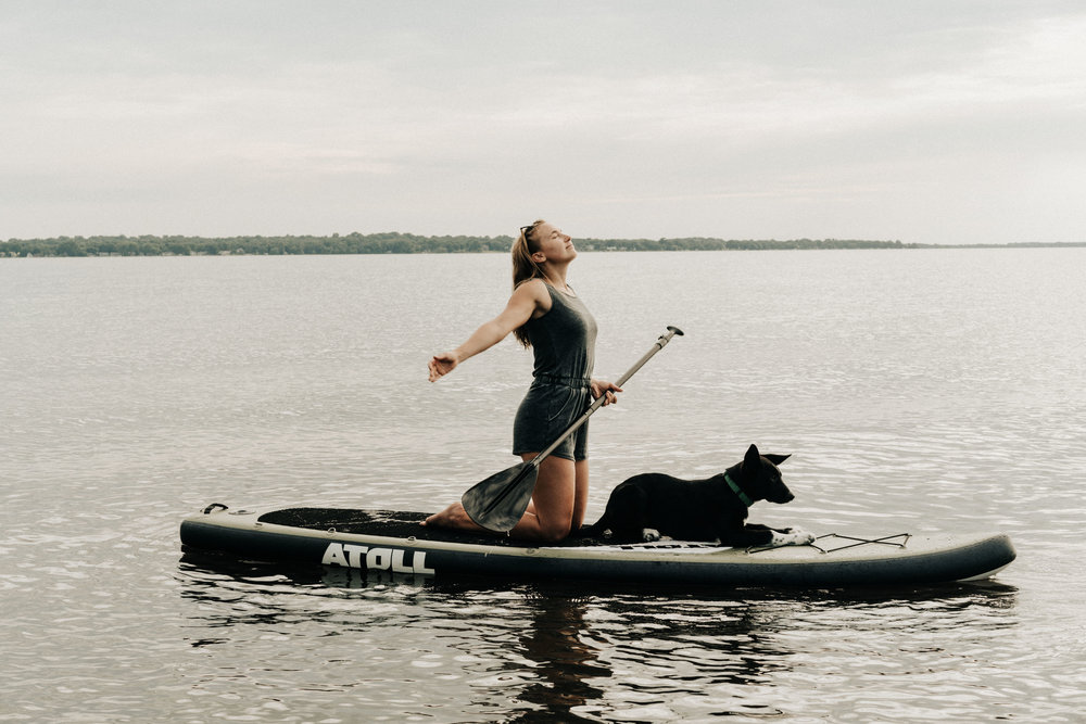 Paddle Board girl and dog
