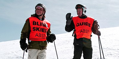 Blind skier and guide