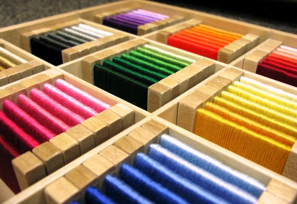 This material, called the color tablets, is typicallymanufactured from wood or plastic, but this teacher made her own set using embroidery thread (which is closer to the tablets Maria Montessori originally designed). I'm impressed!
