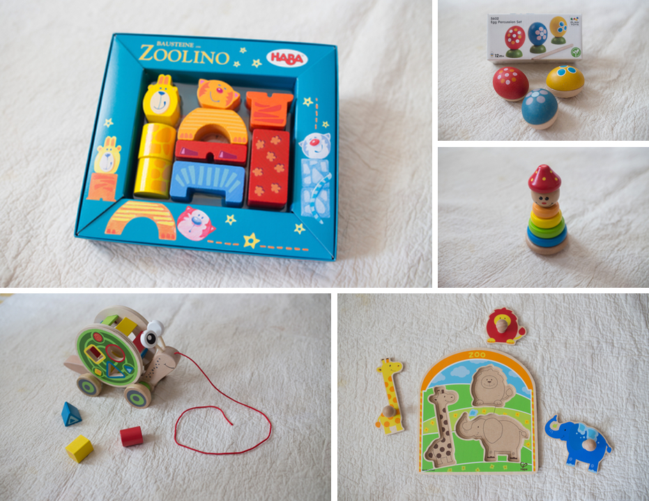 Clockwise from top left: HABA Zoolino Building Blocks, Plan Toys Egg Percussion Set, Hape Clown Stacker, Hape At The Zoo Knob Puzzle, and Hape Walk Along Snail