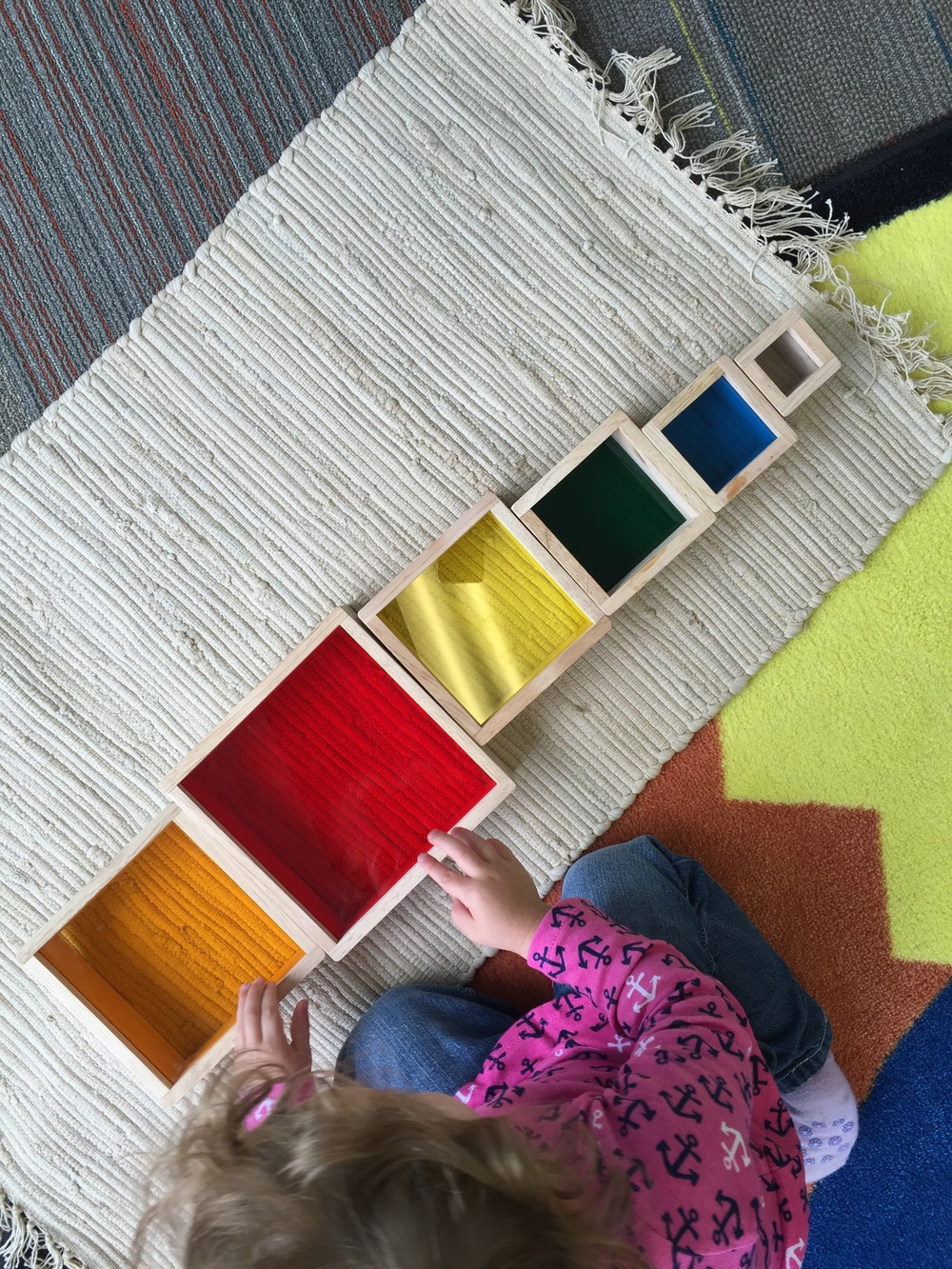 This rainbow tower has been getting a lot of use since I bought it weeks ago. There are so many ways to use it - stacking, arranging, peeking through the colored plexi... or just good old fashioned pretend play.