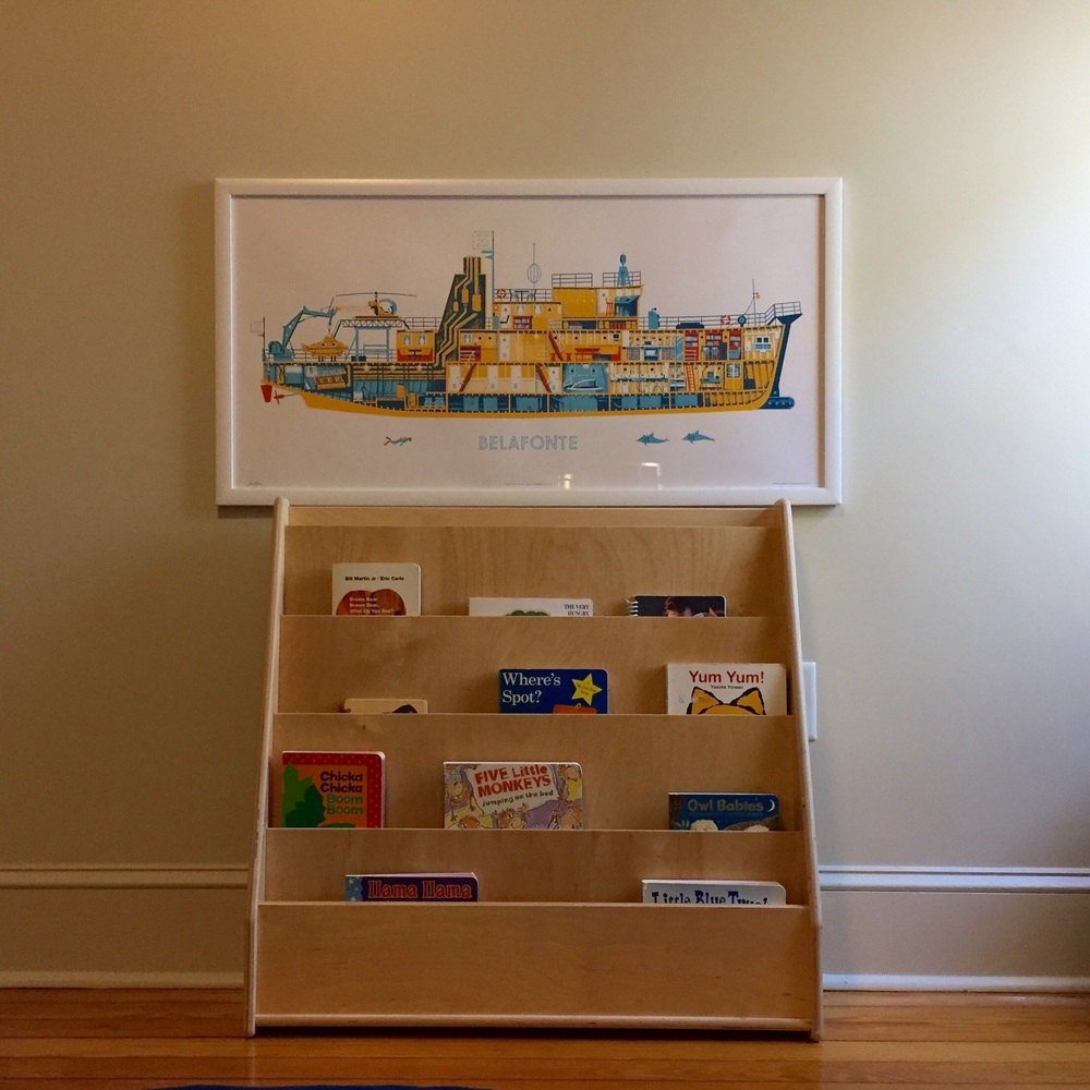 "For Wilson's first birthday, we asked for this bookshelf. It's sturdy and will get lots of use for many years! I change out the books slowly - when he hasn't chosen one for a while, I try something different. Rhyming books, lift-the-flap, and books with photos are his favorite ""genres"" right now."