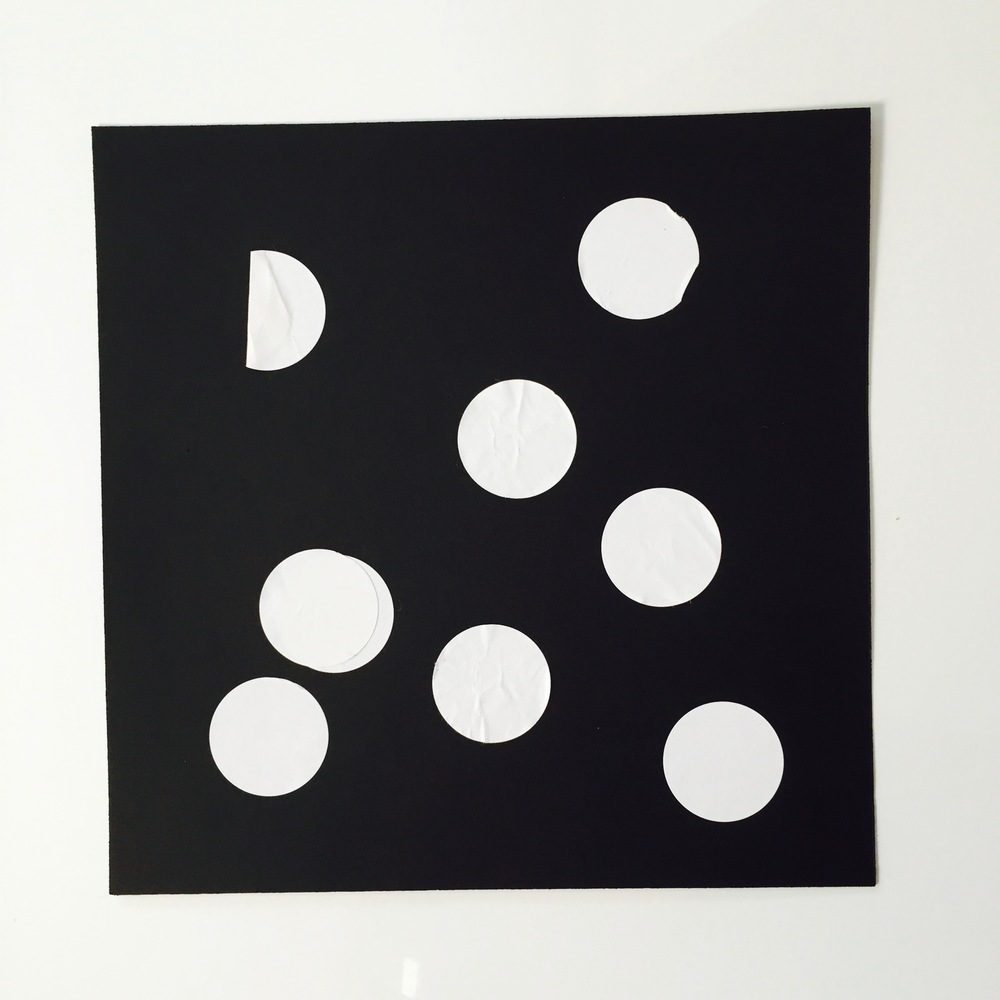 This is the first piece of art Wilson made. It's a black piece of cardstock with with stickers. It was challenging for him and really exercised his pincer grip. The high contrast of the white on black was certainly a point of interest!