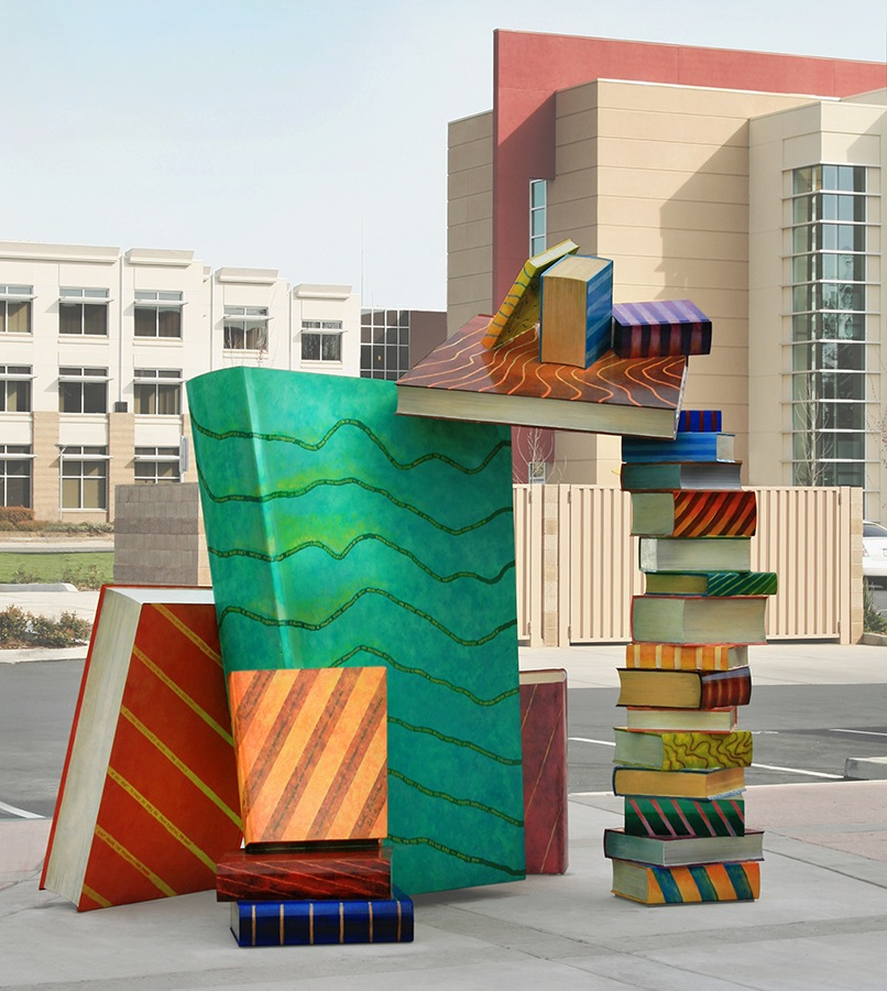 Catch a Book ,  2010 9' x 9' x 7' polychrome steel sculpture, Arthur F. Turner Library, West Sacramento, CA  The precariously placed books have literary quotes from authors representing the cultural diversity of the city while the book jackets illustrate local geography and agriculture.