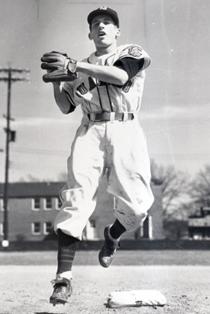 A rare photo of Mr. I from his playing days. A scrappy middle infielder who perfected the art of floating above the field, Mr. I didn't make it to the show, so he bought a big league team instead. Oddly, none of his players can float.