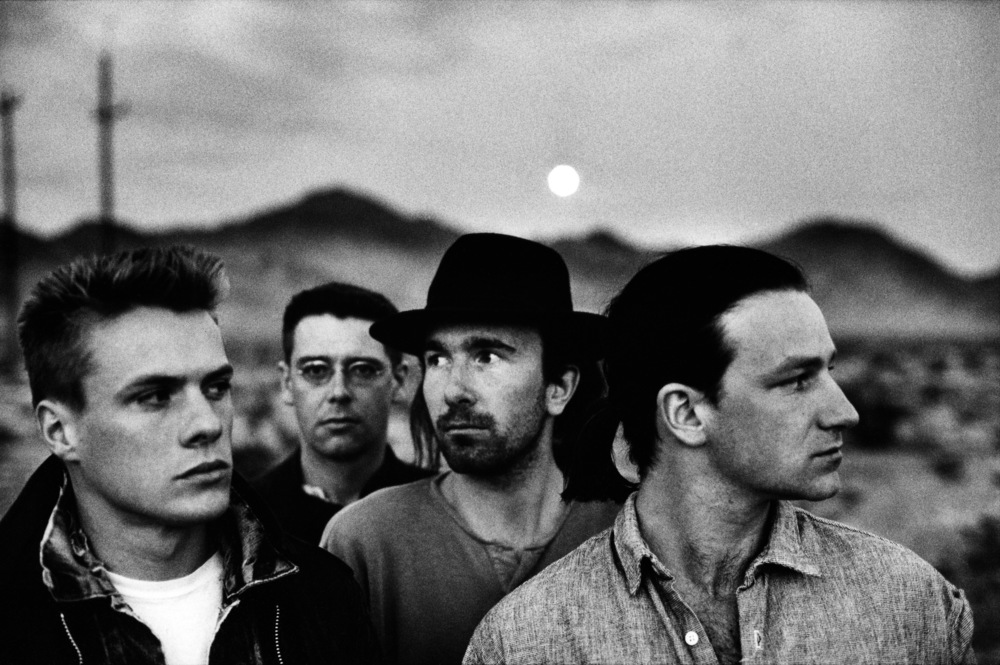 Bono is the guy on the right. All four lads are wanted for postal fraud in connection with a scheme to reproduce rare Irish stamps commemorating the birth of Paddy Finnegan, a.k.a. McPaddy. Shortly after this photo, Bono began wearing sunglasses indoors.
