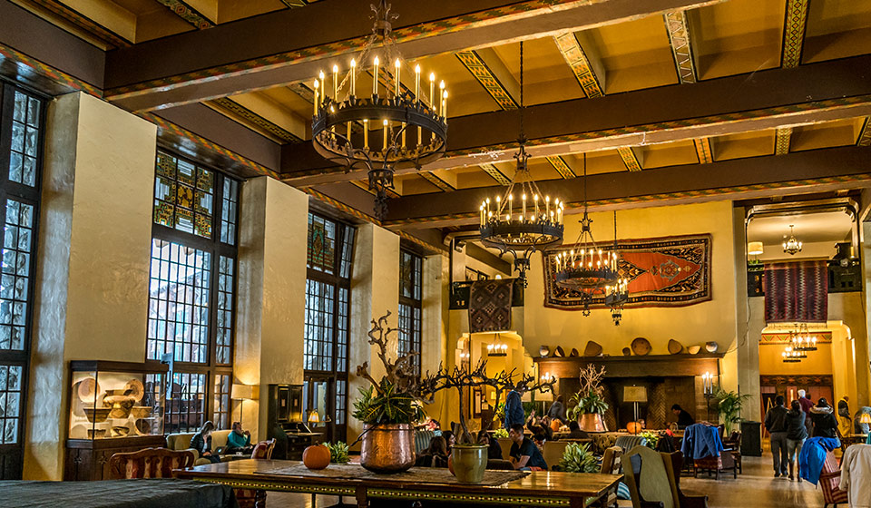 """One of the many soaring public places at The Majestic Yosemite Hotel. The Bearded Man has started a petition to return the hotel to its original name of Ahwahnee, an Indian word for """"deep, grassy valley where no tie is required.""""."""
