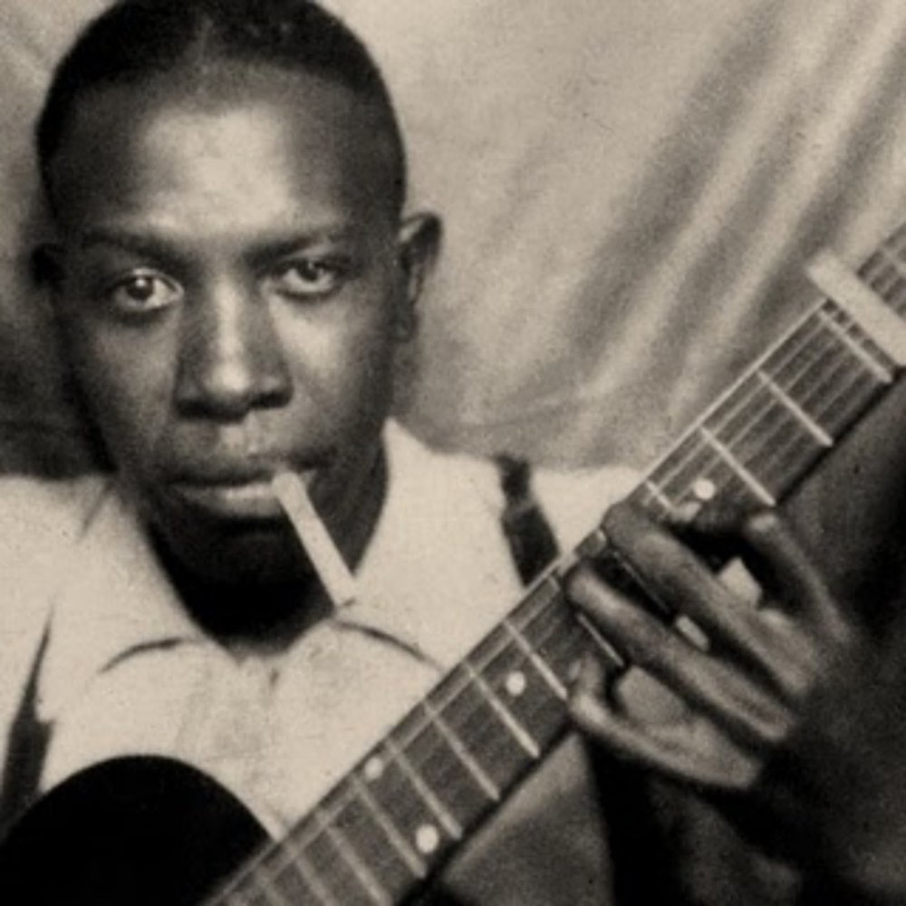 Legendary bluesman Robert Johnson, who traded his soul in exchange for the ability to play the guitar like no other.  The devil also threw in a pack of smokes.