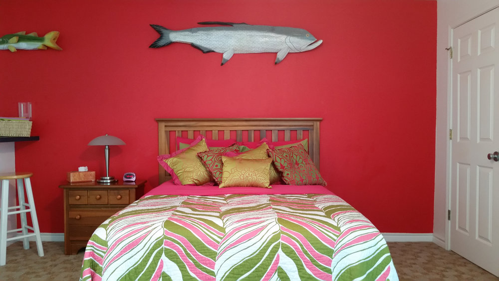 My bedroom at the Poco Loco Lodge. That's not a marlin on the wall - The marlin was in the other room. Those are pillows on the bed. Lots and lots of pillows. I bet the owner knows the decorator at the W.