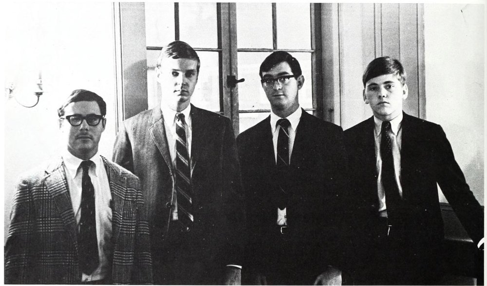 These fellas look innocent enough. But behind the cheery disposition, cheap suits and bad haircuts lurks a quartet of CIA operatives. The white socks gave them away.