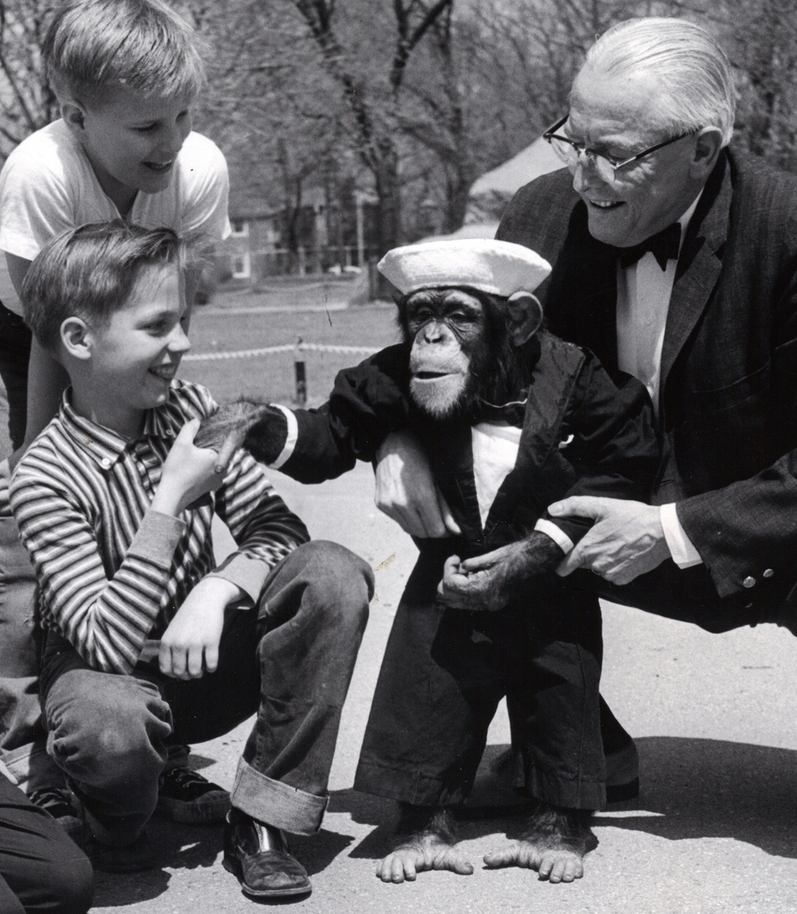 Jo Mendi the Wonder Chimp, seen here with two of my older brothers. The man on the right is Jo's agent Felix Dexstein. Every time Felix gently squeezed his belly, Jo passed gas. Much to the delight of my brothers and more than likely the dismay of Jo Mendi the Wonder Chimp.