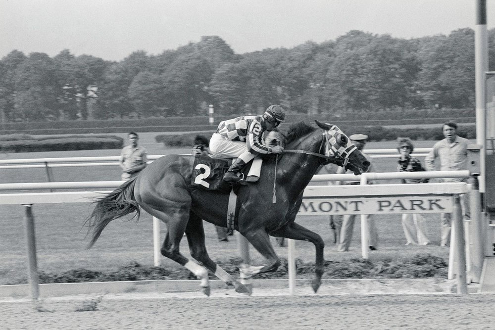 Springdrops jockey, Ted Koezinsky, seen here winning by several lengths the week after I bet on him. The couple in the background, Bobbie and Kip Jordache, had won a radio contest and were allowed to watch the race from the infield. They did not bet on Springrops to win. Losers.