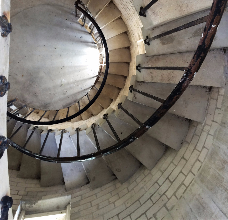 STAIRCASE LEADING TO THE LIGHTHOUSE OBSERVATION TOWER.  CANT'T CLIMB WITHOUT THINKING OF A BUTTON SEA SHELL. OR ALFRED HITCHCOCK.
