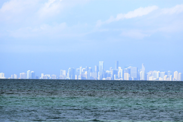 MIAMI WITH A LONG LENS FROM FROM THE LIGHTHOUSE ON BOCA CHITA KEY. IT SHIMMERED IN THE DISTANCE OZ-LIKE, RADIATING A SILVER TINTED BLUE.  I'M PRETTY SURE I COULD SMELL A GOOD CUBAN SANDWICH.
