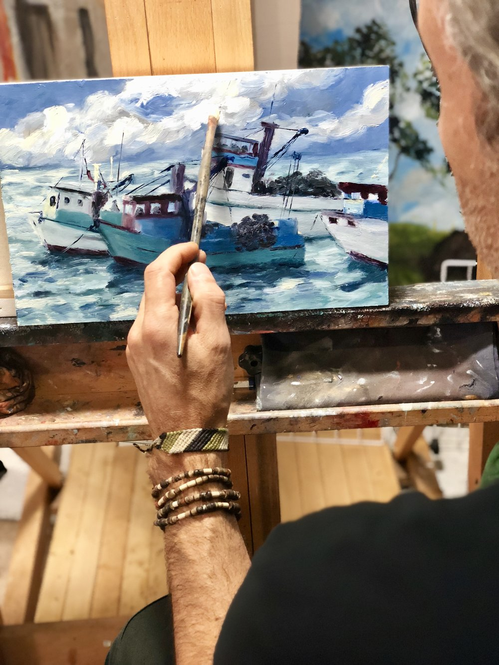 """Here working on """"Bolicheras de Puerto Lopez',  inspired in Puerto Lopez, a small fishing village in Ecuador. This painting will be displayed at the Open Studios Exhibition through the middle of November."""