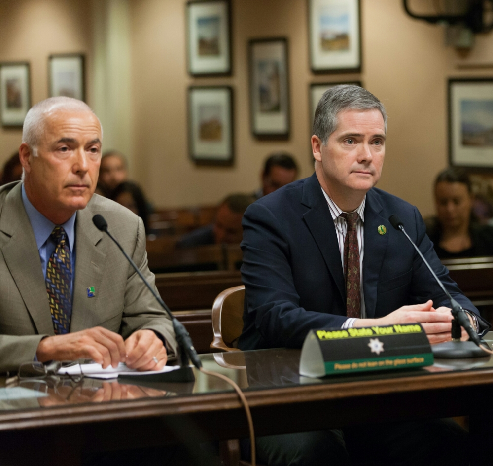 Campbell (left) testifies with Assemblymen David Hadley in front of the CA State Assembly Committee on Utilities & Commerce