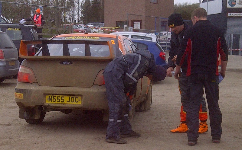 Must have been muddy on the stages and Joe gives the stickers a clean. Jock's boots are clean - hope his Holy Socks are too.