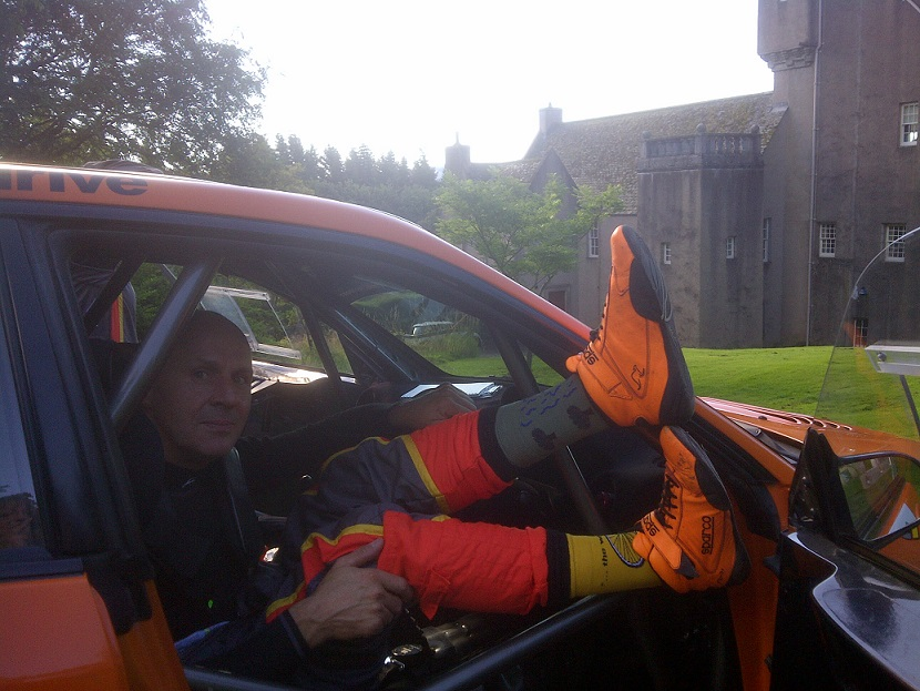 Showing off his Holy Socks before the start of the rally, Jock is sporting a combination of The Whirling Wheels (cycle version) and The Healing Leaves.  Co-driver Paul and the rest of the team got a whole pair of The Healing Leaves.  The pair (Jock and Paul and their socks) finshed fifth overall and third of the MSA ARR Craib Scottish Championship runners.  The Championship will be decided at the Armstrong Galloway Hills Rally in September in Castle Douglas.
