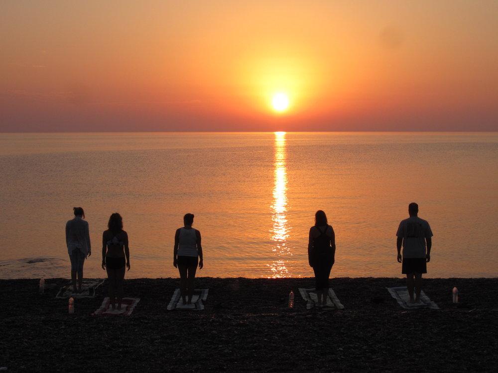 Sunrise yoga on our beach