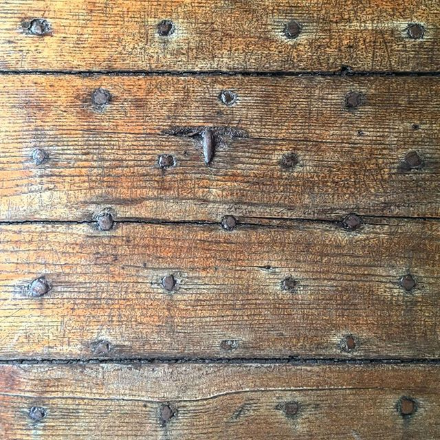 Door Detail - When form meet function. Intricate nail pattern serves as both. #antiquated #woodworking