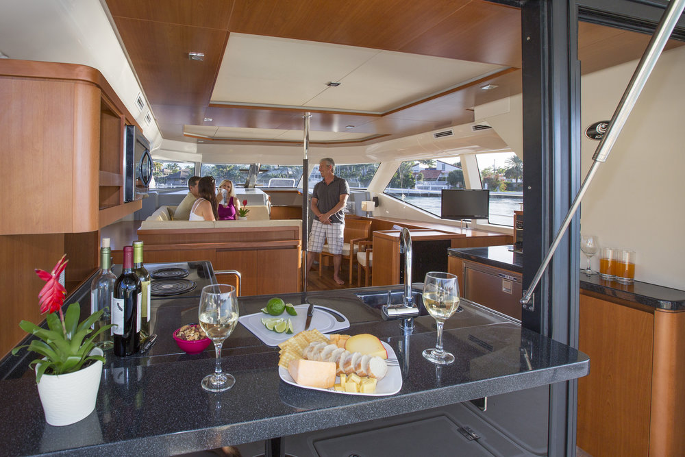 MarineMax 443 salon seating and galley bar.jpg