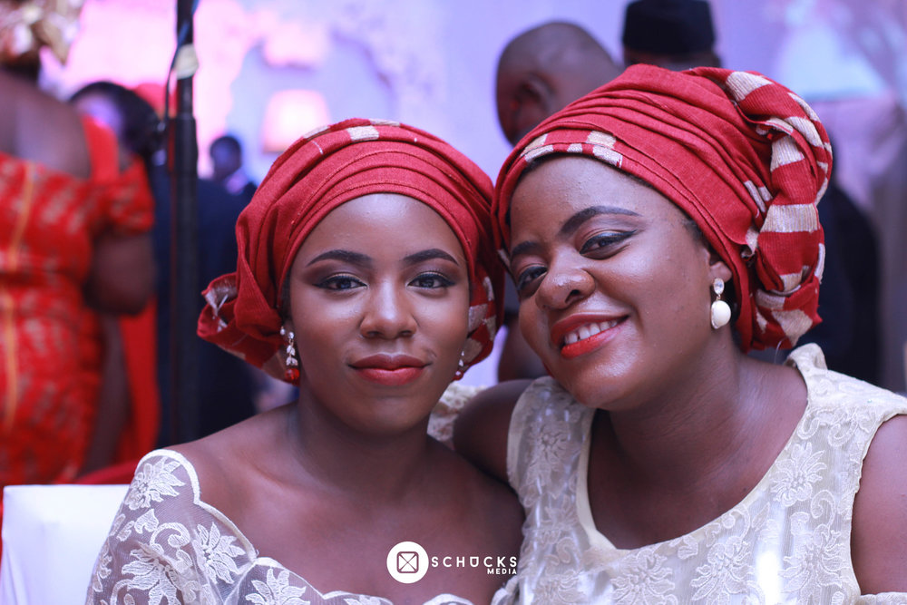 Two young ladies in Aso ebi at a wedding in Lagos