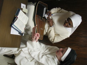 Sr. Mary Jacinta takes notes as Sr. Maria Teresa goes over the psalm tones.