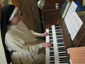 Sr. Mary Cecilia practices the organ in our basement rec room.