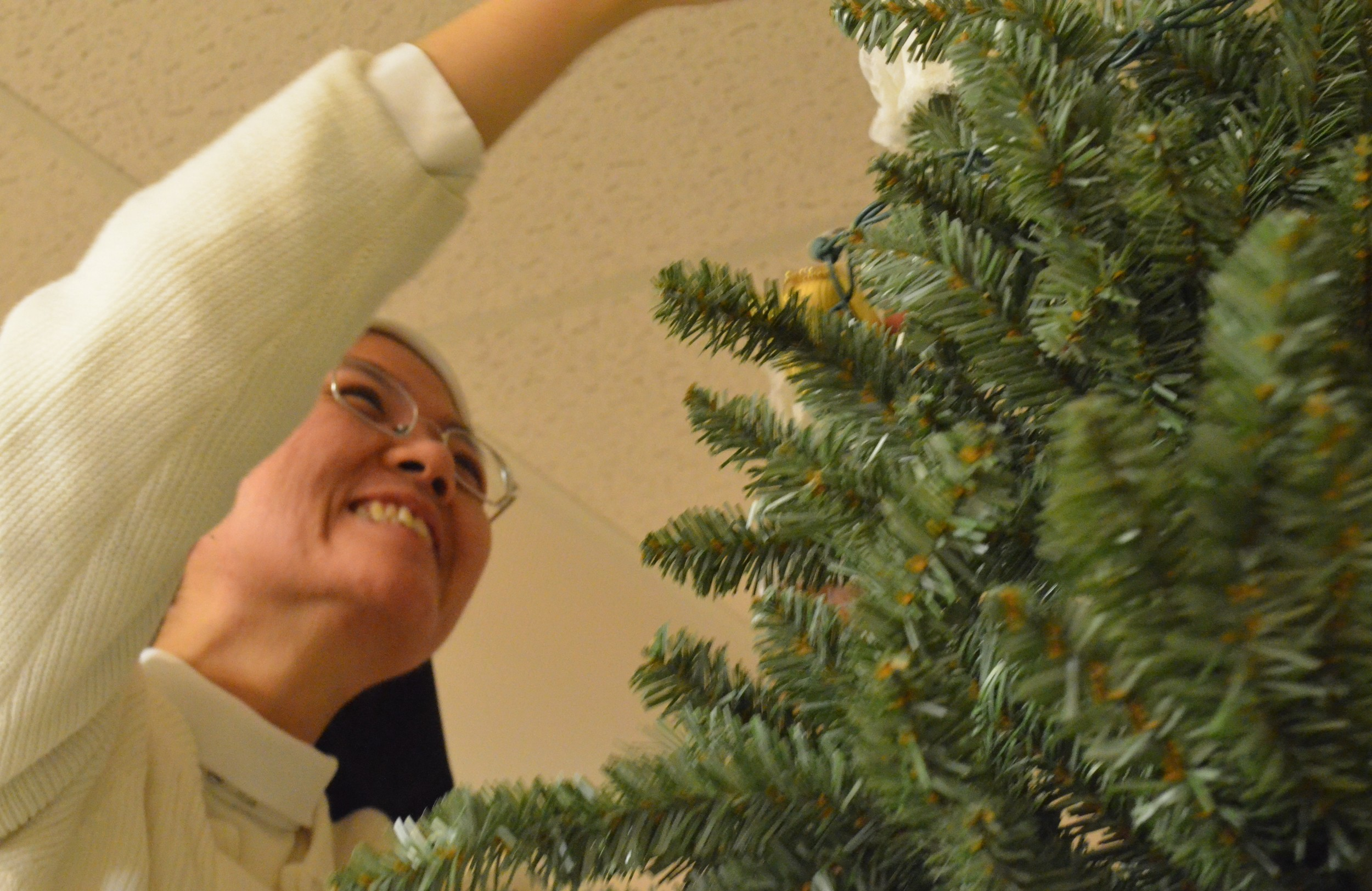 Then top the tree off with an angel of star! ...wait...what's so funny, Sr. Joseph Maria?