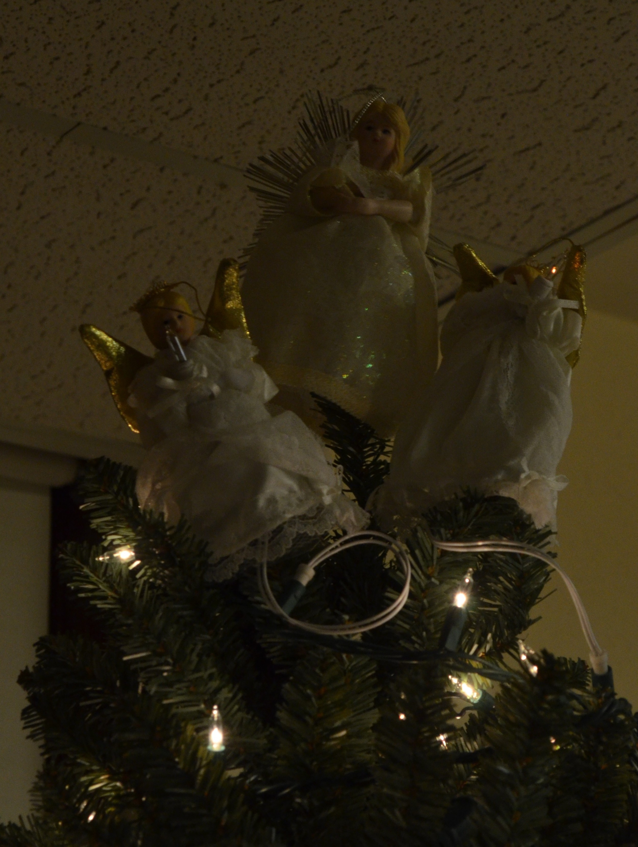 Three angels?!  No, it's a creative representation of the Trinity!