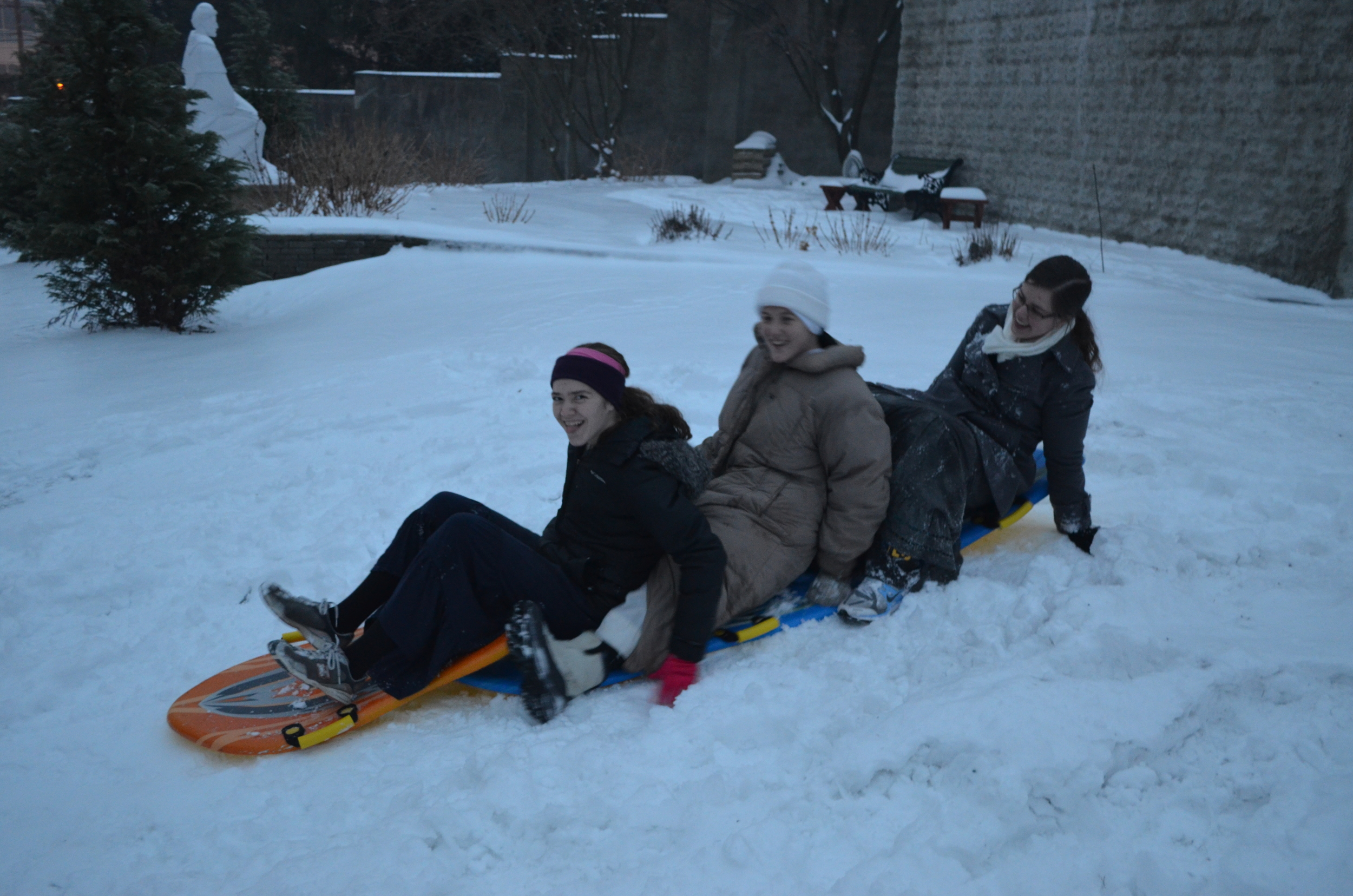 Marie, Sr. Mary Magdalene, and Emily enjoy a bit of sledding before the party.