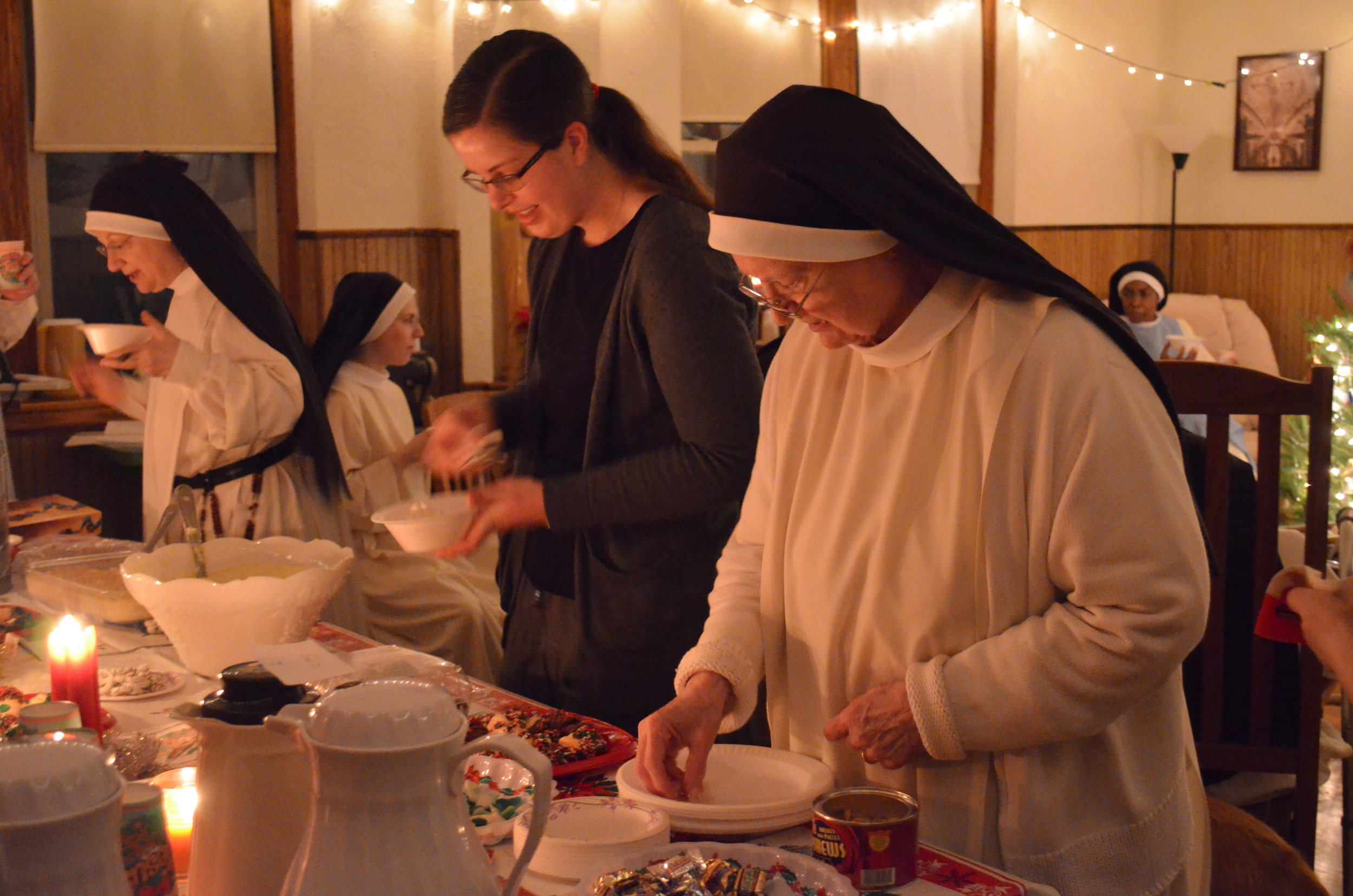 Emily and Sr. Maureen survey the spread of cookies, pudding, and hot cocoa.