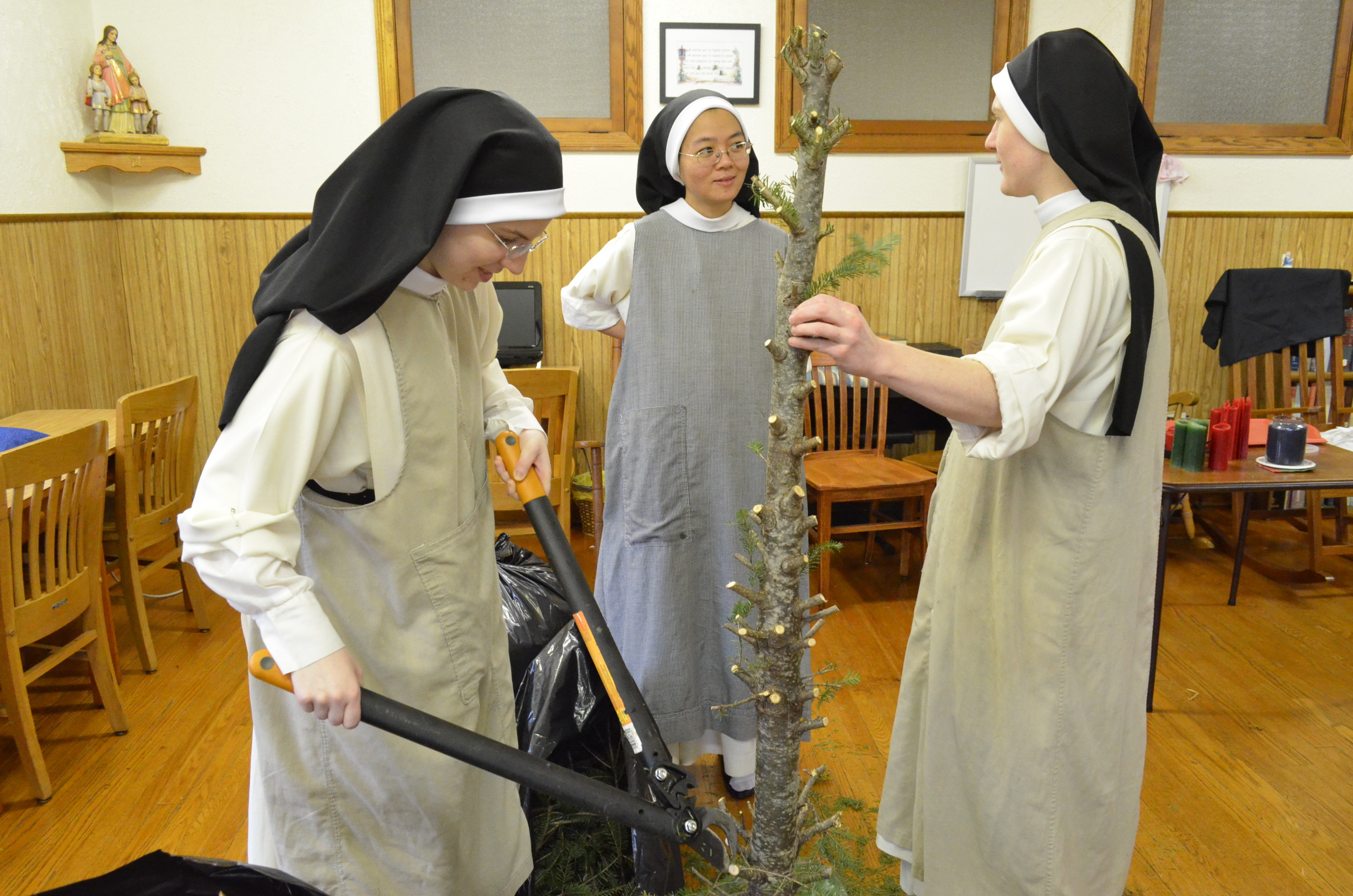 "The Novitiate came up with a novel way to dispose of their donated ""real"" Christmas tree...cut it up! (Sr. Joseph Maria and Sr. Mary Magdalene came up to help)"