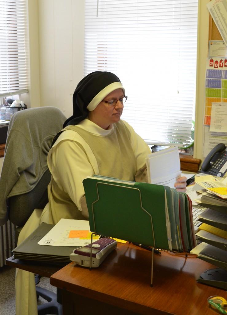 Infirmarian, Sr. Judith Miryam, organizing files