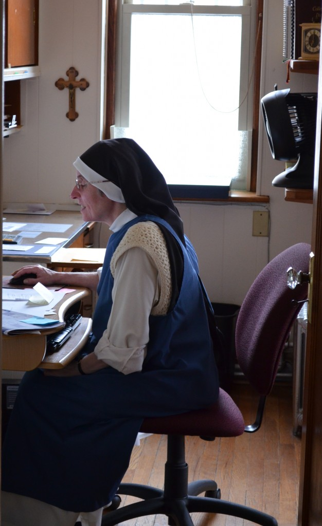 Sr. Mary Martin, our prioress, working in her office.