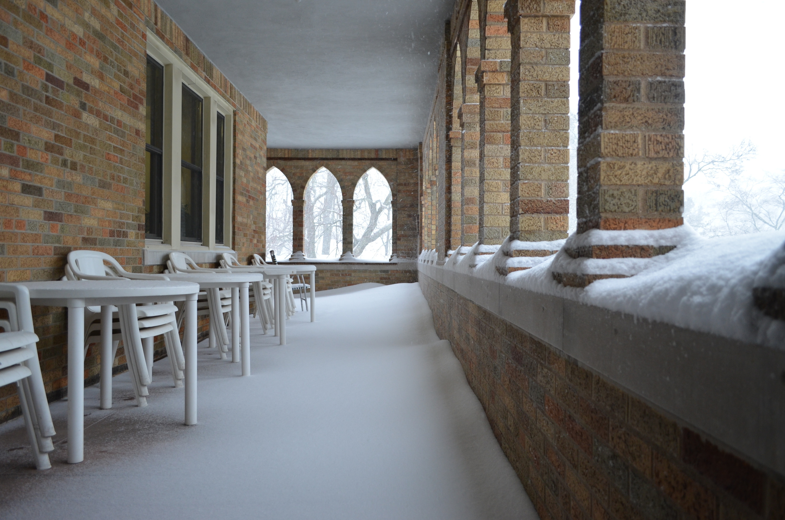 Our picnic tables on the cloister look out of place with all this snow.