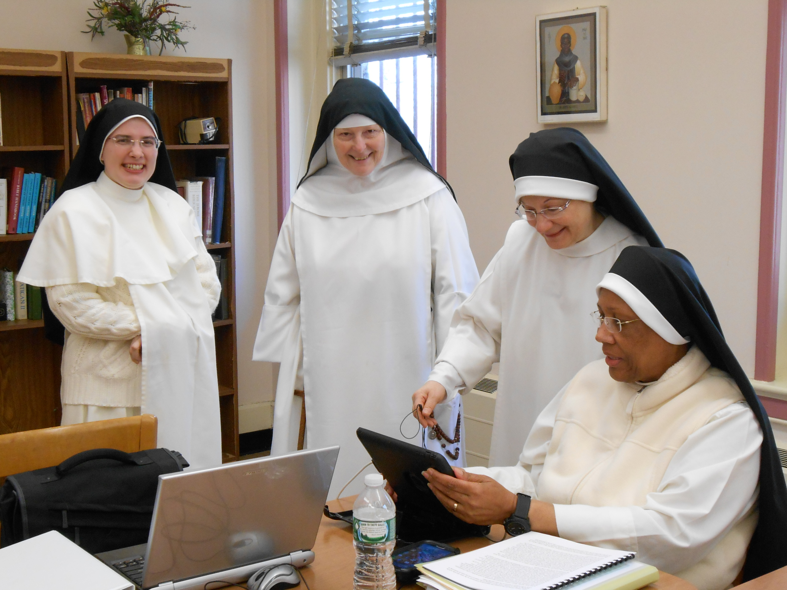 Sr. Anna Marie shares photos during a break.