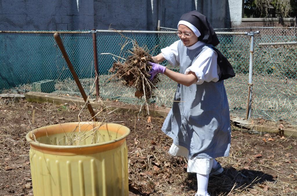 Sr. Joseph Maria clears her garden.