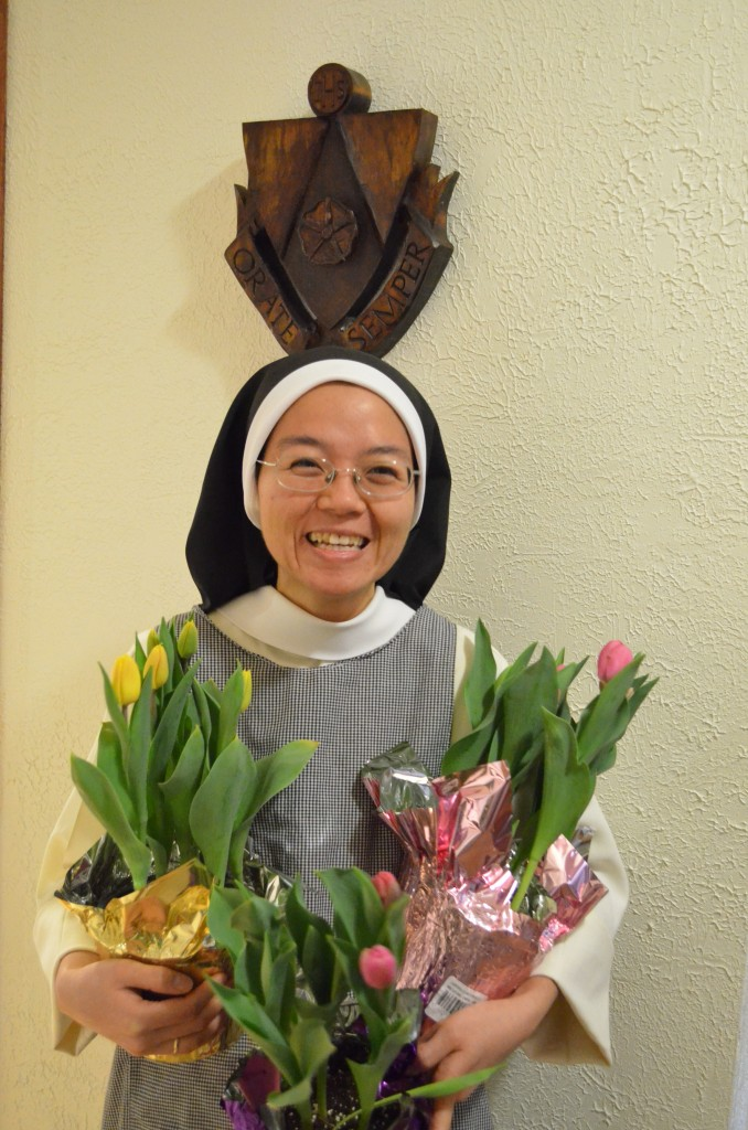 Sr. Sacristan with our three lone tulips.