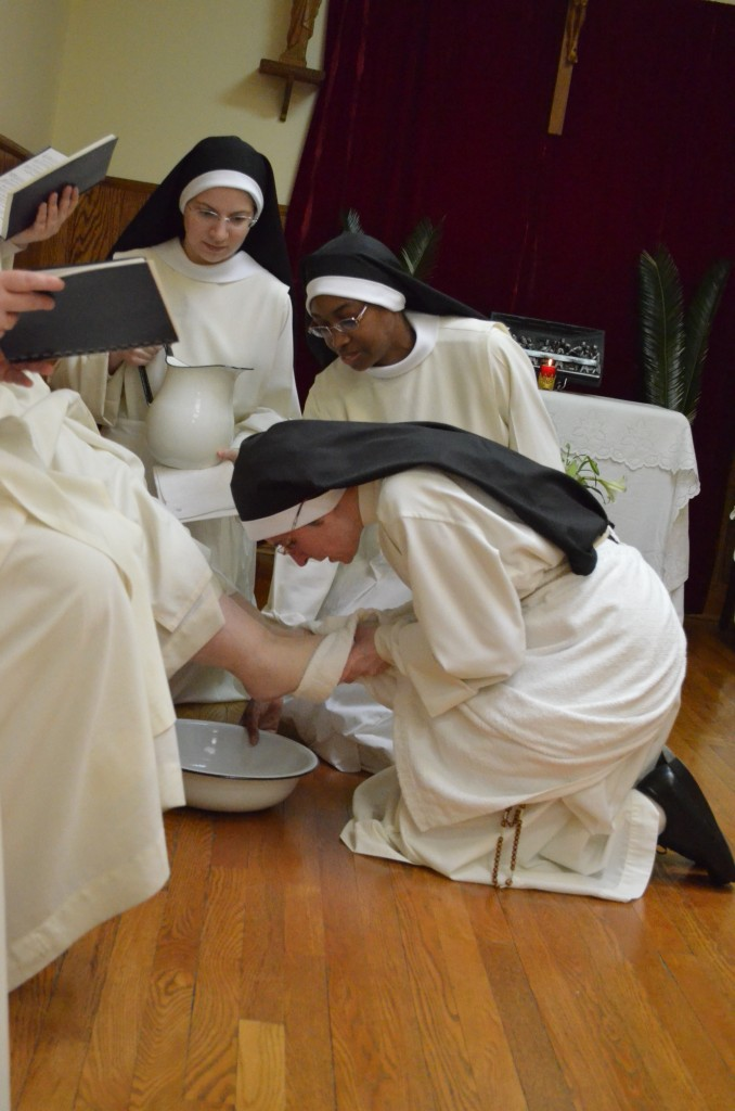 After the sermon, the Prioress goes to each sister washing and kissing her feet. Two sisters accompany her with water basin and pitcher.