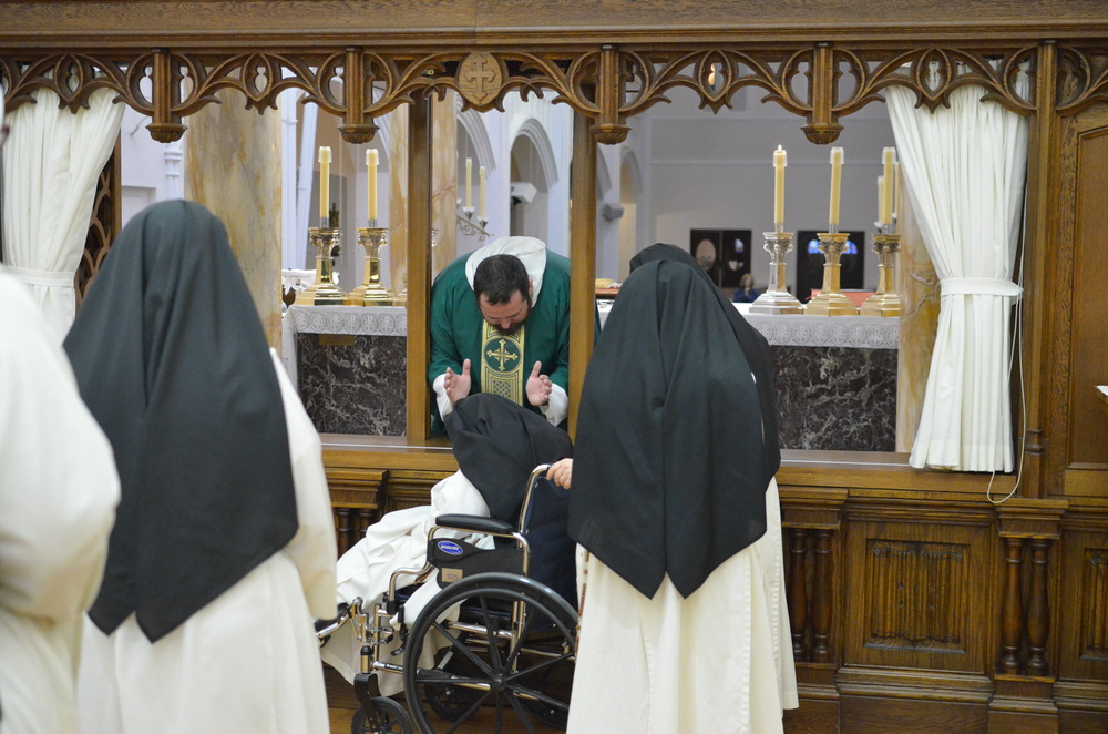Fr. John blesses Sr. Mary Daniel, our eldest sister.