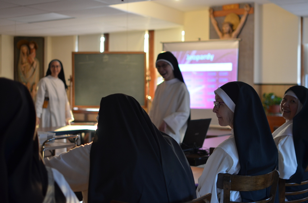 """Sr. Marie Therese created a jeopardy game in honor of Sr. Mary Magdalene's solemn profession. The topics were """"Dominican History"""", """"Church History, """"Scripture"""", """"Kansas"""", and """"Sr. Mary Magdalene"""". Lots of fun was had by all!"""
