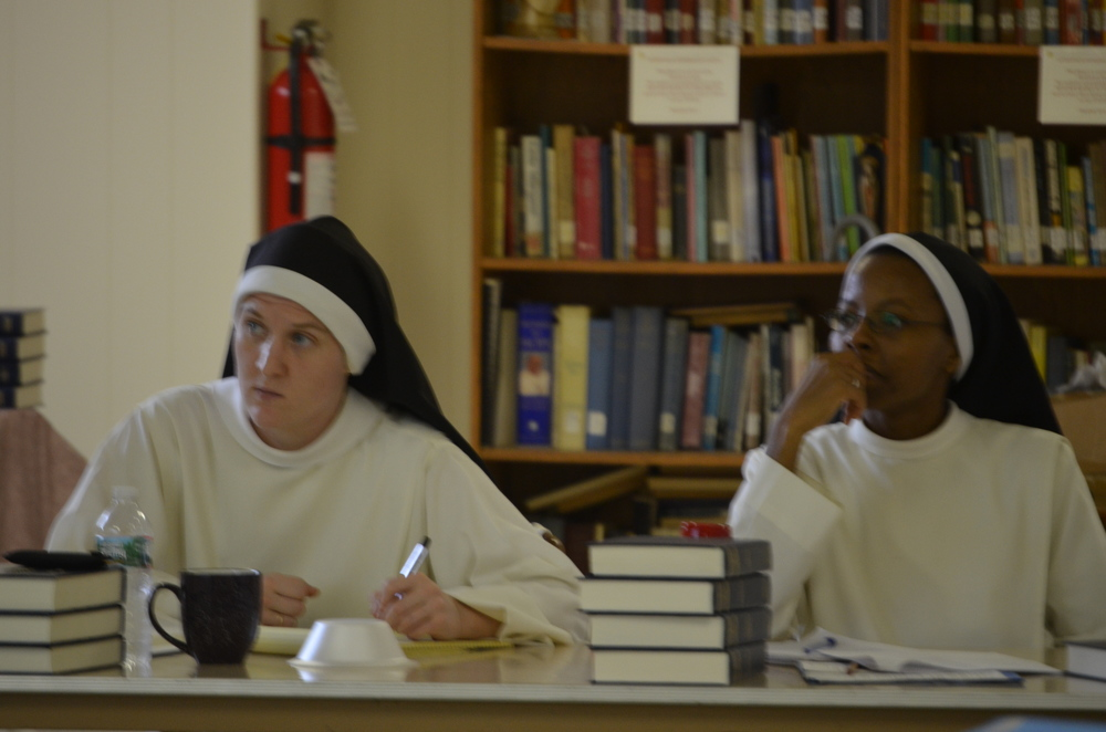 Sr. Mary Magdalene and Sr. Francisca listen intently during class.
