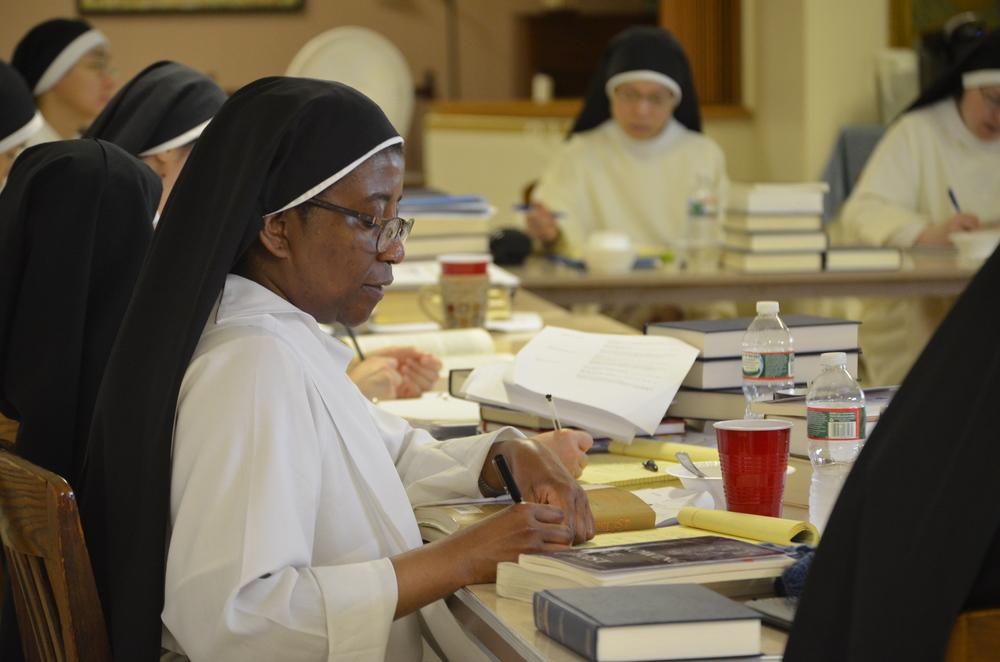 Sr. Maria of Jesus takes down notes.